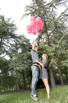 Guy Is Flying Away, Girl Is Holding Him Stock Photo