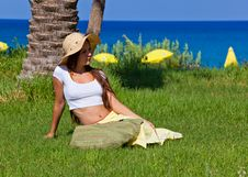 Free Woman Is Sitting On Green Grass Near The Sea Stock Photography - 16334652