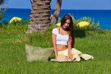 Free Woman Is Sitting On Green Grass Near The Sea Royalty Free Stock Photography - 16334677