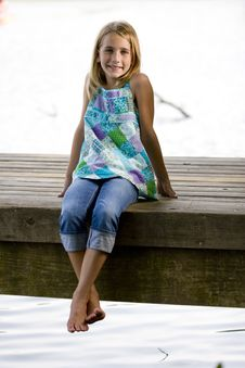 Free Young Tween Girl Sitting On A Pier Royalty Free Stock Image - 16337026
