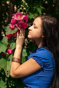 Beautiful Girl With Red Flower Royalty Free Stock Photo