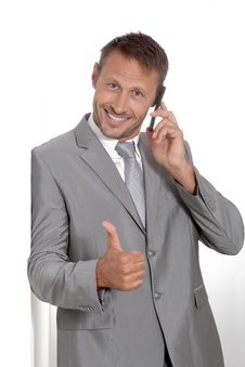 Free Smiling Businessman With Thumb Up Royalty Free Stock Photo - 16339275