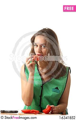 Free Girl Eat Tomato Stock Photography - 16341852