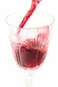 Red Wine Being Poured From A Bottle Into A Glass Royalty Free Stock Images