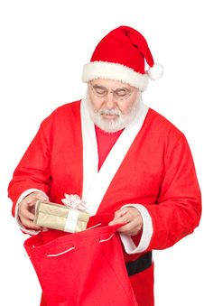 Free Santa Claus Getting A Gift From His Sack Stock Photography - 16343302
