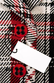 Blank Price Tag On Checked Coat With Red Buttons Stock Photography