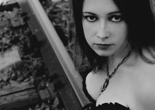 Free Beautiful Gothic Girl Is Sitting On Rails Royalty Free Stock Photography - 16343777