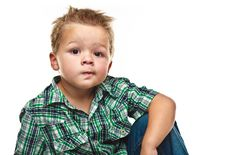 Free Adorable Little Boy Looking Pensive. Stock Photography - 16345142