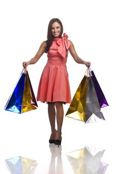 Free Pretty Young Woman With Bags Of Purchases Royalty Free Stock Photo - 16345175