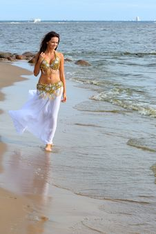 Free Beautiful Young Girl Walking On Beach Royalty Free Stock Photo - 16348605