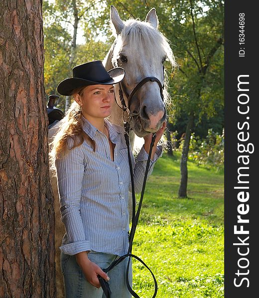 Girl-cowboy and white horse
