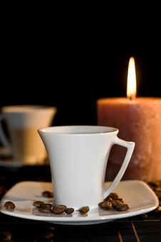 Free Candle And The Cups Of Coffee. Stock Images - 16350214
