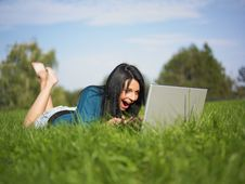 Free Young Girl Using Laptop In Park Royalty Free Stock Photo - 16351525