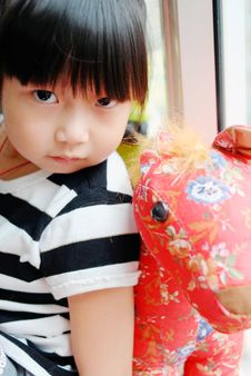 Free Asian Child And The Toy Horse Stock Photography - 16360052