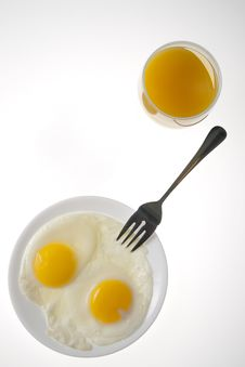 Breakfast Eggs And Orange Juice Stock Photo