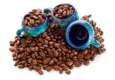 Free Coffee Beans And Cups On A White Background Stock Images - 16362194