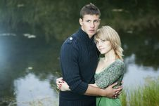 Happy Couple On The Lake Royalty Free Stock Photos