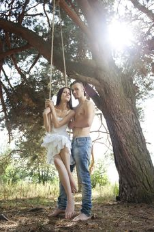 Free Young Happy Couple Swinging Stock Images - 16363154