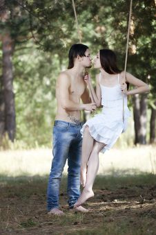 Free Young Happy Couple Swinging Royalty Free Stock Photography - 16363167