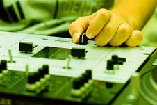 Free Hand Of A Dj Adjusting The Crossfader Stock Photos - 16367453