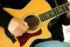 Man Strumming Guitar Royalty Free Stock Photos
