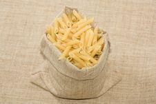 Burlap Sack  Full With Raw  Macaroni Stock Image