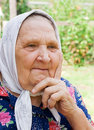 Free Old Woman In A Scarf Royalty Free Stock Photo - 16377265