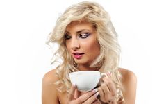 Free Blonde Girl With A Cup Of Coffee Royalty Free Stock Image - 16371716