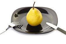 Free Yellow Pear On A Black Plate With Fork And Knife Stock Photos - 16373823
