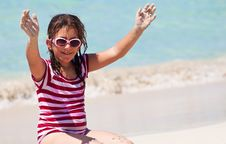 Free Girl With Sunglasses Sitting In The Sand On A Beac Stock Photo - 16375050