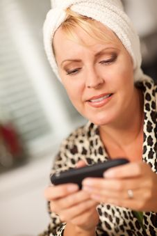 Attractive Woman Texting With Her Cell Phone Royalty Free Stock Photos