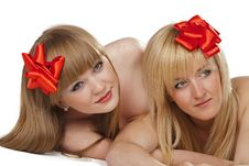 Free Two Smiling Young Women With Gift Red Bow Stock Image - 16377221