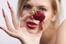 Free Women Holding Single Strawberry Royalty Free Stock Photo - 16377285