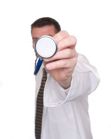 Sharply-focused Stethoscope Pointed By Doctor Stock Photography