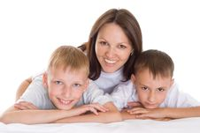 Free Smiling Mom Sitting At The Desk With Sons Royalty Free Stock Photo - 16383065