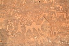Free People And Camels Carved Into A Rock Wall Stock Photos - 16383393