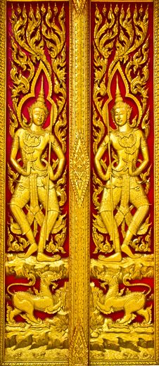 Free Angel Carvings Door Thai Church. Stock Photos - 16383863