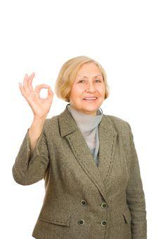 Free Smiling Senior Business Woman Showing Okay Symbol Royalty Free Stock Image - 16383926