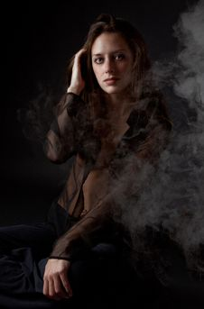 Free Woman In Black With Smoke Royalty Free Stock Photo - 16387295