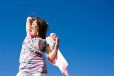 Free Happy Brunette Playing With A Scarf In The Summer Stock Photos - 16388003