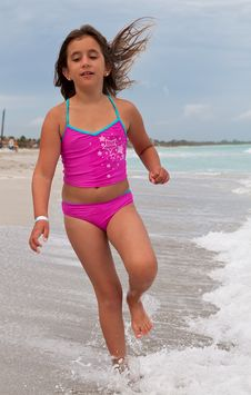 Free Girl On A Pink Swimsuit Running On A Beach Royalty Free Stock Photo - 16388205