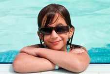 Free Girl Wearing Sunglasses  In A  Swimming Pool Stock Images - 16388764