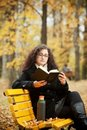Free Young Woman Reading Book In Autumn Park Royalty Free Stock Image - 16394916
