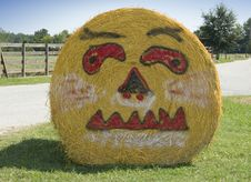 Pumpkin Face On Bale Of Hay Royalty Free Stock Photos