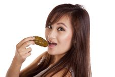 Free Woman Eating A Pickle Royalty Free Stock Images - 16391979