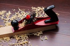 Free Red Plane On Brick And Shavings. Stock Photos - 16392653