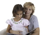 Mother Reads To The Daughter The Book Royalty Free Stock Photography