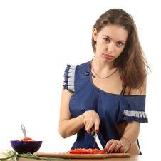 Free Girl Slice A Tomato Stock Photo - 16393100