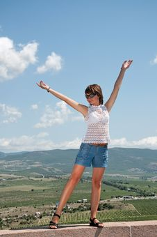 Girl Is Standing With Hands Up Royalty Free Stock Image