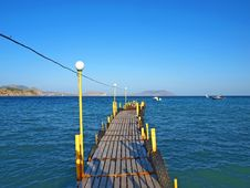 Free Wooden Moorage Goes To The Sea Royalty Free Stock Photo - 16393525